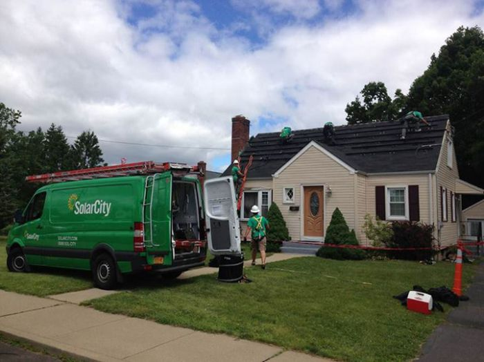 SolarCity installing solar on a Conn. home. Courtesy SolarCity's Facebook page.