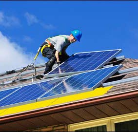 Installing solar on a roof.