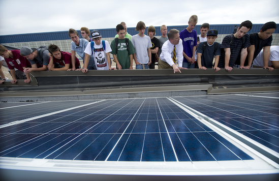 Students look at a solar array at their school in Littleton, Colo. Courtesy NREL.