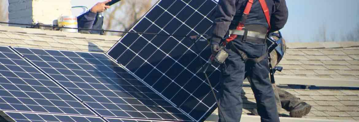 Solar Installers On A Roof